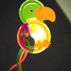 Parrot project made with paper plates, feathers and paper. We made this at the daycare center I used to work at. Toddlers, preschoolers and school aged children made these. School Age Crafts, School Age Activities, Daycare Crafts, Craft Activities For Kids, Preschool Crafts, Crafts For Kids, Daycare Ideas, Toddler Daycare, Toddler Crafts