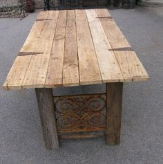 Table made from door and salvaged window gaurds.