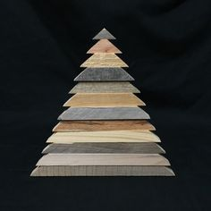 Wooden Christmas tree, made from reclaimed wood pallets.  Approximately 9.25 tall.  Handmade.  Wooden tabletop or wall decor. If you choose to hang on a wall, you may need to remove the wooden stand, due to thickness.  Alternating brown & gray tones of varying widths & thicknesses.  As these are one-of-a-kind pieces made from reclaimed materials, each tree is unique. If you need to see a photo of the actual tree you would receive, please feel free to send us a convo.