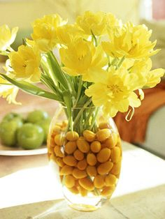 Sunny cheer    Place yellow flowers--in this case, double yellow tulips--in a clear vase with festive kumquats and water. They'll add a touch of spring to your dining table or any corner of your house.