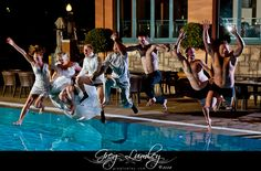 Bridal party jumping in pool.  Wedding photos taken at night.  Night shoot by wedding photographer Greg Lumley.