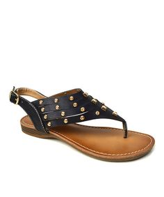 Feet look oh-so chic when sporting these sweet sandals. A buckle strap on the side provides an adjustable fit and opens up to let polished toes slide inside. The studded strap offers an edgy tough of feminine fashion without the alternative attitude.