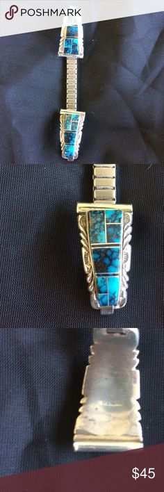 Zuni inlay stretch wing tips These tips are spider-veined turquoise and jet, framed by ornate sterling silver attached to a SS stretch band. The tubes are 10/16s of an inch and the inlay (without the metal border) is 1 and 1/16 inch from tip to tip. The metal border is 1/8 inch all around the inlay. The stretch band itself is 3 and 3/4 inches tip to tip. Jewelry Bracelets