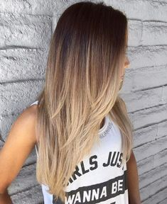 this cut and cascading ombré #goals Long Layered Brown To Blonde Ombre