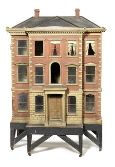 Large early painted red brick wooden dolls house on stand, English circa 1840.
