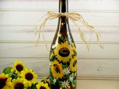 Used this pin as inspiration to paint my wine bottles with Sunflowers but added wire and beads and cork candle.  2013.  Love it..looks great on my table.