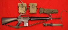 The XM16E1 is shown with 2 universal pouches. These pouches were used with the M-14, & were carried over for use with the M-16 in Vietnam. Also the bipod and its XM3 pouch  standard M bayonet & its M8A1 scabbard...   ◄ All this information, was with the original image.►