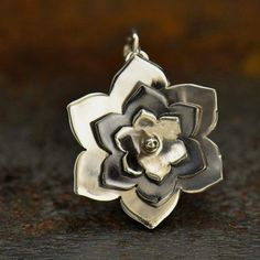 Sterling Silver Three Layered Riveted Flower. This beautiful charm is a unique take on a classic flower charm. Each petaled layer is its own separate piece that is riveted in place, but all can spin…MoreMore #SilverJewelry