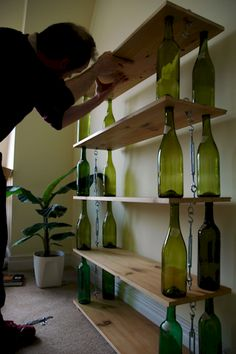 8. Upcycle wine bottles into this awesome shelf                                                                                                                                                      More