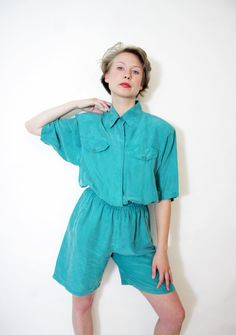Vintage green silk jumpsuit. Jumpsuit: A garment incorporating trousers and a sleeved top in one piece, worn as a fashion item, protective garment, or uniform.    [Hanis Amani Binte Zainal FD1A1]