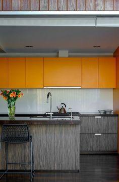 Yellow-orange upper kitchen cabinets