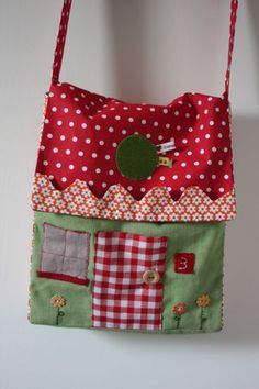 House bag - this looks like a messenger bag that's been modified into a pretty snifty house bag - what a great gift this would be for kids!  There are a few more photos on the website :)