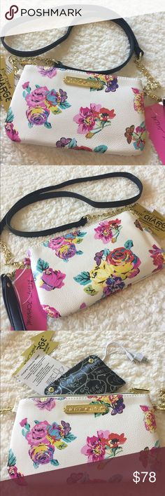 "🌺NEW! BETSEY JOHNSON CHARGING CROSS BODY BAG BRAND NEW! AUTHENTIC BETSEY JOHNSON CHARGING CROSS BODY BAG-Approximate Measurements are 9"" X 4"", & the strap is detachable with an approximate strap drop of 23"".Can also be used as a wristlet....Please refer to pics for the phones, that are compatible.... Betsey Johnson Bags Crossbody Bags"