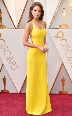 Eiza Gonzalez in yellow bodycon low back Ralph Lauren gown on red carpet at 90th anniversary 2018 Oscars Academy Awards
