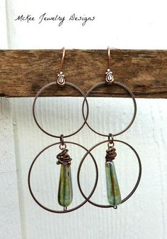 Long copper hoops with Czech glass in green earrings. McKee Jewelry Designs