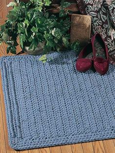 "Fancy Ridges rug - Raised ridges across both ends give rich detail to this room accent. Rug is worked with four strands of worsted weight yarn using a size J/10 crochet hook. Size: 29"" x 41"".Skill Level: Intermediate"