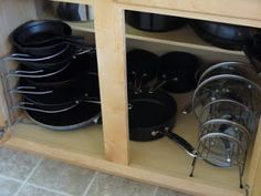 kitchen - pan rack from Target $12 (she has cast iron in it and says it works fine), lid rack under $10.