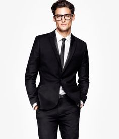 A black suit. A man M U S T own a black suit. Wedding/funeral/church -A black suit should always be an option. The best part about a black suit, basically E V E R Y colored tie goes with a black suit.