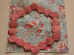Shift around a ring of Hexes to best frame a big motif, then applique. Aindi's Cottage: Happy New Year!.  - English Paper Piecing