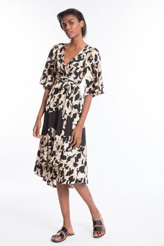 Wrap Kimono Dress - It's all about the wrap in our kimono dress with flutter sleeve detail. Add your high boots and you are ready to go!!!