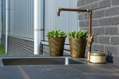 Detail of the copper outdoor kitchen tap
