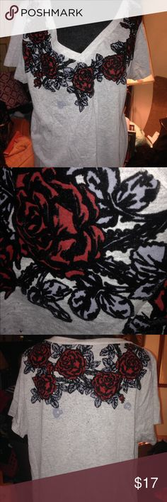 Torrid Flowered Tshirt SZ 2 (18/20) GORGEOUS NWOT Beautiful Torrid Flowered Tshirt. Brand new without tag. Marked a Torrid 2 which fits an 18/20. Great with jeans or shorts or for layering in the winter. Stunning! torrid Tops Tees - Short Sleeve