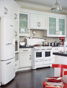 Modern Vintage. The kitchen is accented with beloved 1950s appliances including a Magic Chef range and a Northstar refrigerator. To make the room wheelchair accessible and easier for everyone to use, some countertops were lowered and a pot filler was added near the stove during the kitchen remodeling.