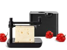 "Nuance Cheese/Slicer Box Black by Nuance. $77.00. Stainless Steel, ABS. Approximate size: 6.5"" x 5.5"" x 5.5"". Here's another essential accessory for any kitchen. From Nuance, this stylish cheese slicer looks fantastic in stainless steel and black with a contemporary cube design. With adjustable cutting height, you slice your favorite cheese for sandwiches, salads and savory suppers."