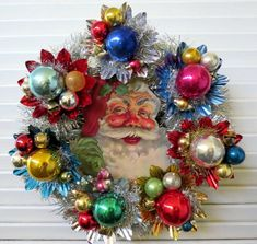 Christmas wreath made from reflectors and glass balls. Would be pretty without S. - Christmas wreath made from reflectors and glass balls. Would be pretty without Santa as well. Vintage Christmas Crafts, Vintage Ornaments, Xmas Crafts, Vintage Holiday, Christmas Projects, Victorian Christmas, Vintage Santas, Retro Christmas Decorations, Vintage Wreath