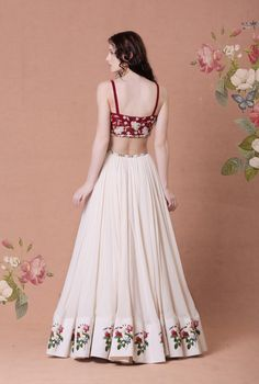 Maroon crepe lycra embellished bustier and ivory crepe lehenga with printed border Material: Crepe lycra, crepe, cotton silk, shantoon Dry Clean Only Indian Lehenga, Indian Gowns, Indian Attire, Indian Bridal Outfits, Indian Designer Outfits, Designer Dresses, Floral Lehenga, Bridal Lehenga Choli, Cotton Lehenga