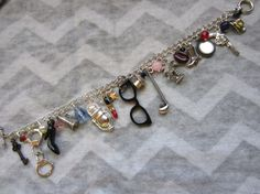 Items similar to Mulholland Drive Charm Bracelet. Sixteen charms + beads inspired by the film. on Etsy Mulholland Drive, Twin Peaks, Cowboy Hats, My Etsy Shop, Embroidery, Pearls, Inspired, Trending Outfits, Glasses
