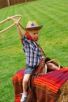 have children sit on hay barrels for lasso game