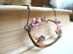RUST Gemstone flower  antiqued brass wire wrapped by http://etsy.me/orhUy9 via #jewelry #gemstones #wrapped