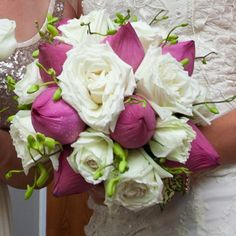 Round; White roses, closed pink lotus with unopened Thai orchid stems as fillers. Weddings in Thailand.