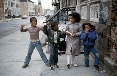 """Muscle Boy and The Little Rascals of Palmetto Street, Bushwick, Brooklyn, NY, May Photo by Meryl Meisler. [""""A Tale of Two Cities: Disco Era Bushwick""""] New York Street, New York City, Vintage Photography, Street Photography, Film Photography, Helen Levitt, Bushwick Brooklyn, New York Pictures, American Story"""