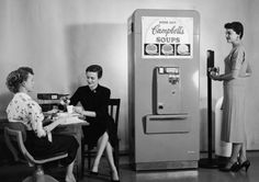 Lovely ladies enjoying the offerings from a Campbell's Soup vending machine while on their lunch break. #vintage #women #office
