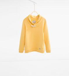 Imagen 1 de Sudadera cuello chal alamar de Zara