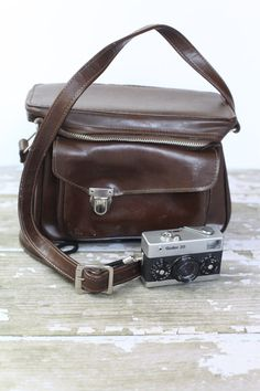 distressed leather camera bag