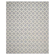 Tufted wool rug in silver and ivory with a quatrefoil trellis motif. Handcrafted in India.   Product: RugConstruction Mat...