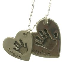 These handprint or footprints are resized to fit, so ideal for adult or child prints.  You may also have a name or initials added to your pendant.  The name can be hand written or a special stamp can be made for just £2.50 if you prefer it in a nice font.