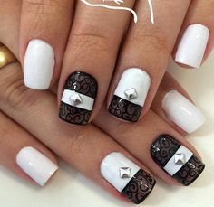 Adding these silver studs to your white nail polish is actually enough to make your nails look better. But this black swirls and white ensemble just makes it the best.