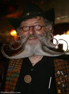 long crazy curly mustache and beard