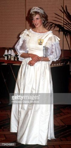 Princess Diana (1961 - 1997) at farewell banquet in Auckland, New Zealand, April 1983. She is wearing a cream taffetta and lace gown by Gina Frattini and the Queen Mary tiara of diamonds and pearls.
