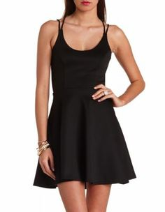 "I've been really feel in the ""skater dress"" look.  Pretty.  strappy back skater dress"