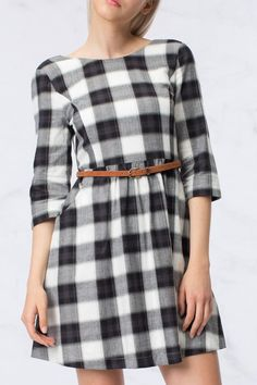 Black and white laid three-quarter length sleeve dress that comes just above the knee. This dress comes above the knee and comes with a brown belt detail. Has a v-neck back with zipper closure with built in lining. Dress does run slightly small.  Black Plaid Dress by HYFVE. Clothing - Dresses - Casual Clothing - Dresses - Printed Cleveland Ohio