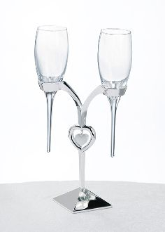 Toast to marriage with this Heart in Heart Champagne Flute Set. This set features a silver plated holder and two toasting flutes that fit perfectly inside the holder. The holder features a silver heart-in-heart design. Wedding Toasting Glasses, Wedding Champagne Flutes, Toasting Flutes, Champagne Gifts, Champagne Glasses, Heart Bubbles, Diy Wedding Supplies, Lillian Rose, Wedding Bubbles