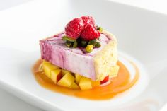 A healthy verbena frozen yogurt and raspberry sorbet terrine surrounded by a pistachio chiffon cake, over fresh local peaches topped with pistachios and black raspberries. Only 130 calories at Rouge Tomate NYC!