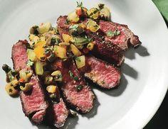 Seared rib-eye steak with tomato-caper relish