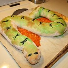 "Spooky Calzone Snake | ""One long calzone, baked in the shape of a snake, can be cut into individual servings after baking. Stuff with your favorite pizza toppings and lots of cheese. """