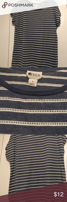 NWOT Stylus Striped Tee XL New without tags from clean, smoke free home. Denim blue color with eyelet lace like white stripes. Very cute, just never worn. Great with shorts, capris, jeans. 65% polyester, 24% rayon, 11% cotton. Stylus Tops Tees - Short Sleeve